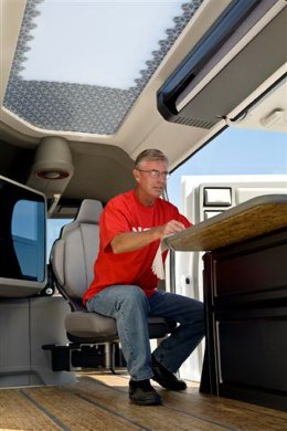 You can set up a complete office on the road in the 2011 Nissan NV2500 cargo van.
