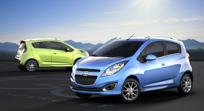 2013 Chevrolet Spark (side view). The squinty-eyed headlights seem a bit oversized for its face since they travel from the bumper all the way to the windshield, but that's just one of the ways the Spark keeps from looking run-of-the mill. Speaking of mills, all you get is an 85-horsepower four-cylinder.