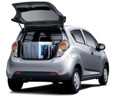 2013 Chevrolet Spark (rear view with hatch open). The rear opening is crowded by the bumper and taillights and, of course, by the rear seat when it's in the upright position. There are no miracles here: the Spark is a small runabout, not a minivan.