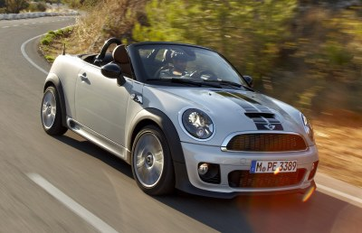 2012 Mini Roadster (front quarter view): All Minis share the same engines that burn premium fuel. However, the base 1.6-litre four-cylinder is good for 7.2 l/100 km in the city and 4.9 on the highway.