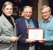 Tony Whitney, president of AJAC, and Jim Kenzie, chairman of the 2003 Car of the Year competition, present Bill Roebuck, editor of CarTest! with the runner-up award for the Jacques Rainville Best Website.
