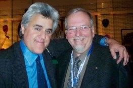 CarTest! editor Bill Roebuck gets the squeeze from NBC Tonight Show host Jay Leno at an event during the North American International Auto Show (NAIAS) in Detroit in 2003.