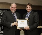 Tony Ensor, Vice-President and General Manager of Pirelli Tire, presents plaque to Bill Roebuck, runner up of the 2005 Pirelli Photography Award (Unpublished), at the AJAC awards ceremony in October 2005.