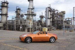 2003 Nikon Automotive Photography Award (Bill Roebuck, Runner-up, Unpublished Category). Photo: Nissan 350Z with Petro Canada oil refinery in background. Location: Oakville, Ont.