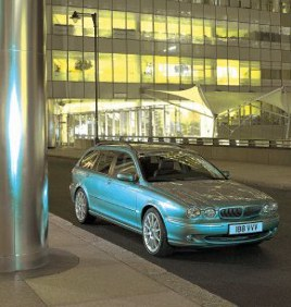 The all-wheel-drive Jaguar X-Type presents a mix of elegant design at the front with a practical station wagon at the back.