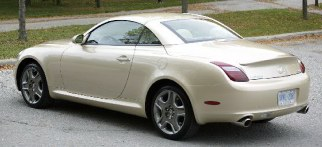 2006 Lexus SC 430 looks like a hardtop coupe with its roof raised.