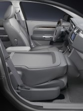 2007 Chrysler Sebring Sedan. Front seat folds flat to extend cargo-carrying capacity or serve as a side tray for the driver.
