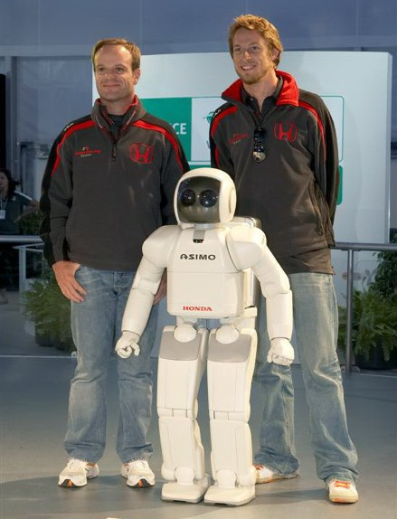 Honda Racing F1 drivers Rubens Barrichello and Jenson Button with Honda's ASIMO humanoid robot at a press conference Thursday evening, June 7, at 'Honda World' on the grounds of Circuit Gilles Villeneuve at the Grand Prix of Canada.