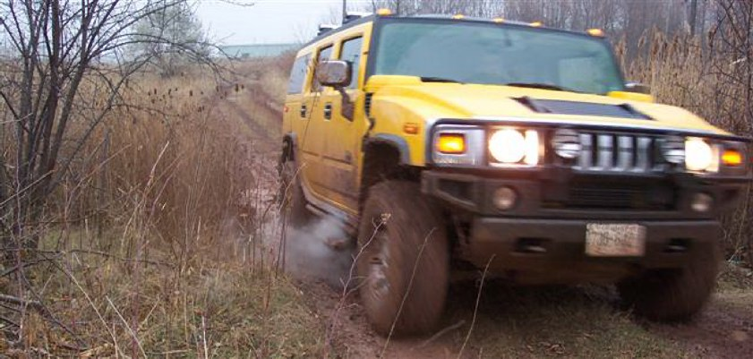 Hummer H2 in the mud. Photo by Bill Roebuck.