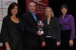 Susan Elliott (L), Manager of Corporate & Product Communications, Mitsibushi Motor Sales of Canada Inc., Jacqui Adams (R), Sophie Des Marais (far right), both of Corporate & Product Communications Mitsibushi Motor Sales of Canada Inc., present Jeremy Cato, accepting for Hank Van de Vondervoort, with the 2007 Mitsubishi Design & Layout Award. Photo courtesy AJAC/Arne Glassbourg.