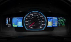 2010 Ford Fusion Hybrid instrument panel features vine leaves on right side that grow or fall off depending on your driving style.