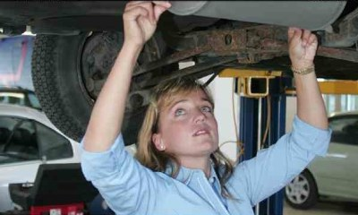 Kelly Williams checks an exhaust system.